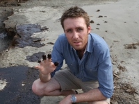 Philippe Cousteau shows oil on his fingertips during the BP Oil Spill.